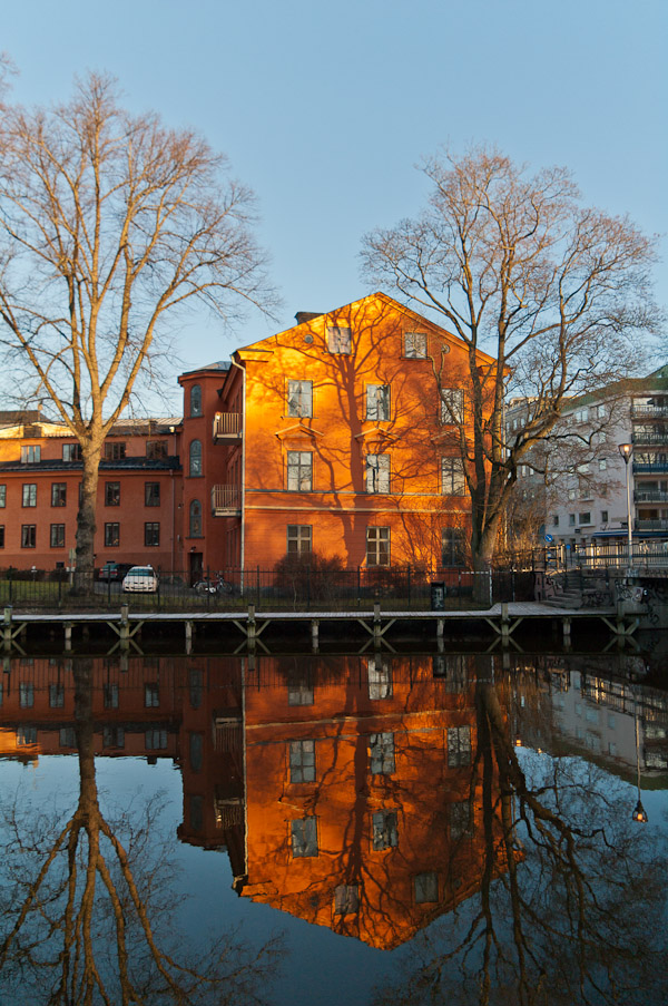Orange house and trees reflected in Fyris river, Uppsala, Sweden
