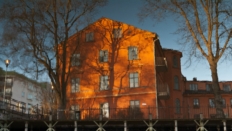 Reflection of orange house, Uppsala, Sweden