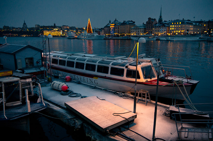 Boat by snow-covered dock, Stockholm, Sweden