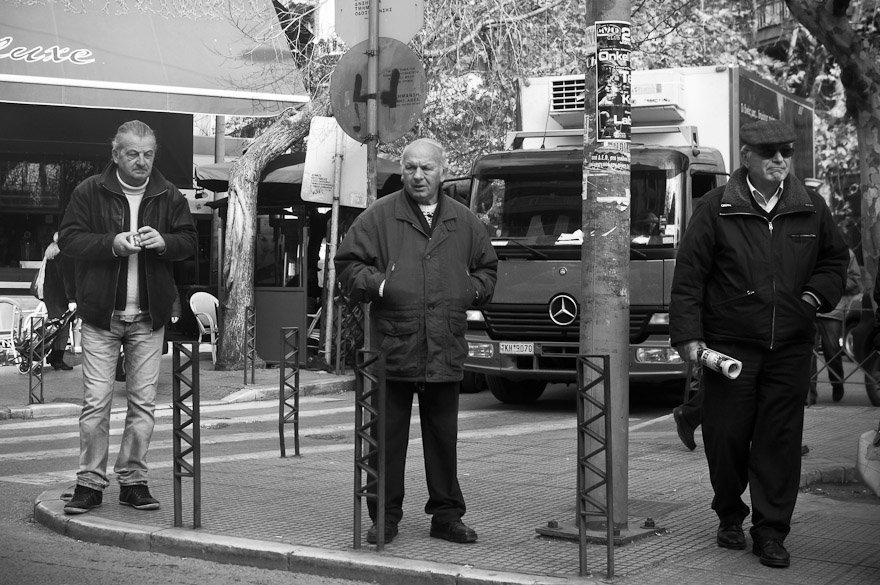 Street shot of three men in Thessaloniki, Greece
