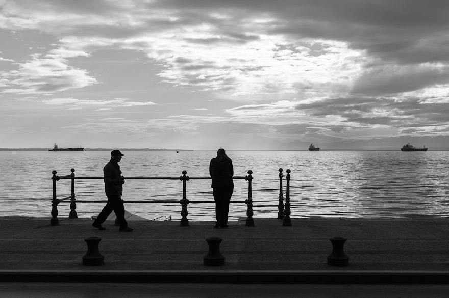 Man and woman by the sea in Thessaloniki, Greece